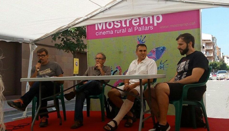 El moderador del debat, Jaume Solé, amb Pep Coll, Ferran Blanch i Octavi Espuga ahir al festival.