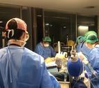 Imatges extretes del vídeo de la Paeria, amb sanitaris atenent malalts de Covid a l'hospital Arnau de Vilanova.