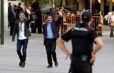 Jordi Cuixart i Jordi Sánchez, aquest matí quan han arribat a l'Audiència Nacional.