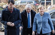 Merkel y Schulz exprimen los plazos para lograr un pacto de gobierno