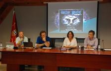 Txema Arnedo i Neo Sala, organitzadors del Doctor Music, amb els responsables turístics d'Aran.