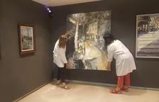 Técnicos del Museu de la Noguera ultimaban ayer el montaje de la exposición, que se inaugurará hoy.