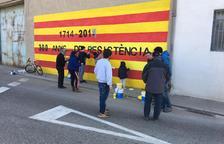 Reposen murals i llaços al Palau