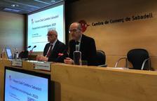 Josep Oliu (izq), junto al presidente de la Cámara de Sabadell.