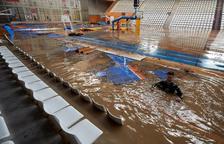 El pabellón Fontajau de Girona, con más de un metro de agua