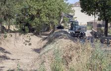 Imagen de los trabajos de limpieza de la ribera del Sió.