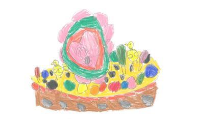 La Gemma té 5 anys i ha dibuixat una mona amb plomes, pollets, lacasitos de colors i un gran ou de xocolata.