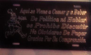 En un bar de Torrefarrera hi ha aquest cartell