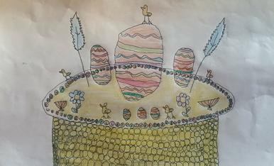 L'Abril te 8 anys i li agradaria una mona de pasqua amb un gran ou al centre i decorada amb flors, pollets, plomes i ous petits de xocolata blanca.