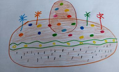 El Blai te 5 anys , ha dibuixa' t la seva mona amb el que més l' hi agrada , lacasitos i un ou de xocolata.