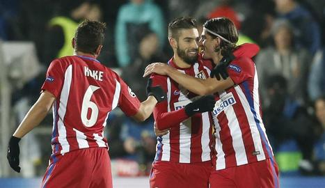 Koke, Yannick Carrasco i Filipe Luis celebren l'únic gol.