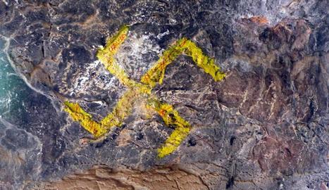 Entre les pintades que van aparèixer a la Cova del Tabac hi havia aquesta esvàstica.