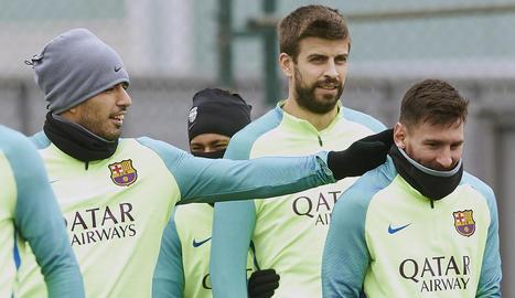 Luis Suárez, Neymar, Piqué i Messi durant l'entrenament d'ahir a la Ciutat Esportiva.