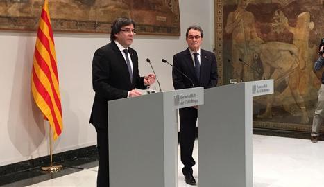 Puigdemont i Mas durant la compareixença posterior al judici pel 9N.