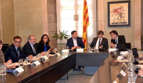 Reñé va firmar el conveni amb Junqueras i el president Puigdemont.