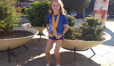 Aran, amb les medalles de la seua curta carrera atlètica.