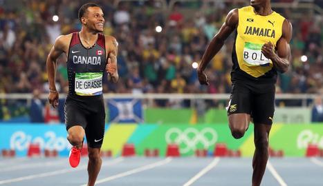 Bolt corrent al costat de De Grasse, absent en el Mundial per lesió.