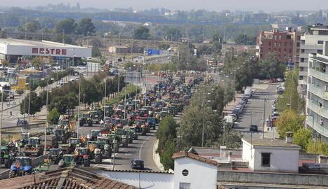 Els més petits van treure els tractors de joguet durant la protesta pels carrers de Lleida.