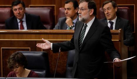 Rajoy i Santamaría, durant la sessió del Congrés celebrada ahir.