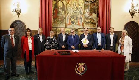 Representants de la Paeria i de la Fecom, Pimec i ADICAE.