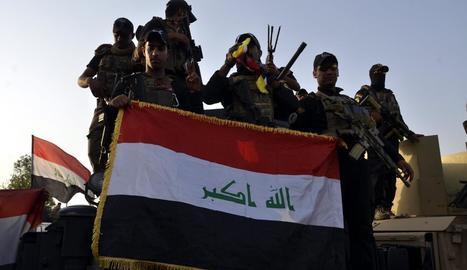 Tropes iraquianes celebren la victòria sobre l'Estat Islàmic.