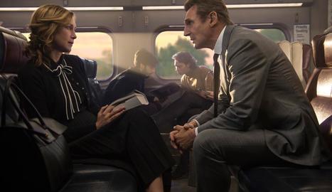 Estranys en un tren