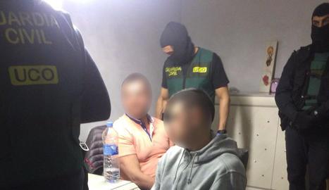 Imatge de dos de les catorze persones que han estat detingudes.