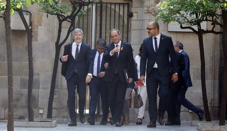 El ministre de l'Interior, Fernando Grande-Marlaska; el president de la Generalitat, Quim Torra, i el conseller de l'Interior, Miquel Buch, abans de la reunió de la junta de seguretat.