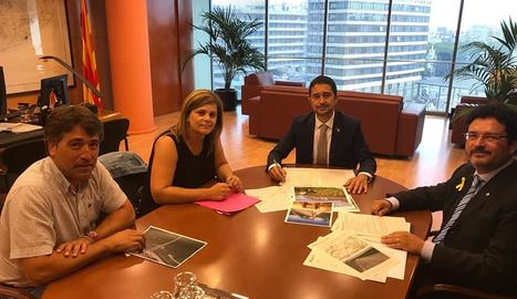 Cañadell, al costat de Calvet i Isidre Gavín, secretari de Mobilitat.