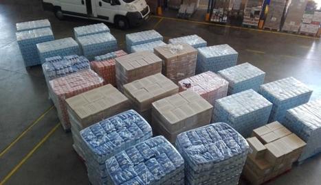 Milers de quilos de sucre, llet i oli al magatzem del Banc.