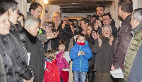 La Coral d'Avui va cantar nadales i va llegir fragments de testimonis al refugi de l'església.