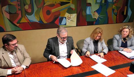 La signatura del canvi d'ús de l'edifici de l'Antiga Audiència.