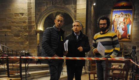 Àlex Mases, el rector Pere Cañada i Andreu Moya.
