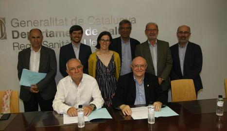 Els responsables de GSS i Sant Joan de Déu, ahir durant la firma del conveni de col·laboració.