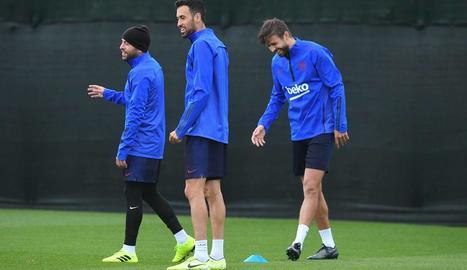 Jordi Alba, Busquets i Piqué durant l'entrenament.