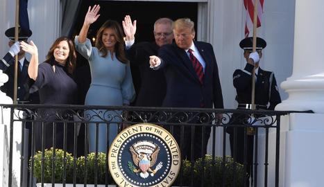 Donald Trump i la seua esposa, ahir a Austràlia.