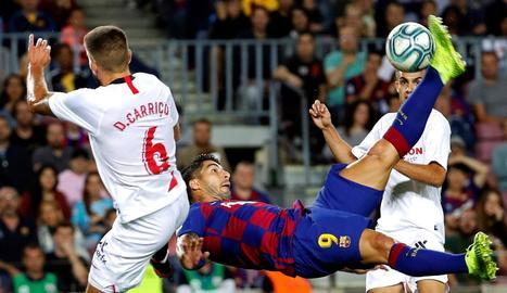 Luis Suárez va marcar un golàs per inaugurar el marcador, amb una xilena davant de la qual no va poder fer res la defensa sevillista.