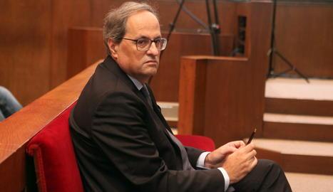 El president de la Generalitat, Quim Torra, aquest dilluns al banc dels acusats al TSJC.