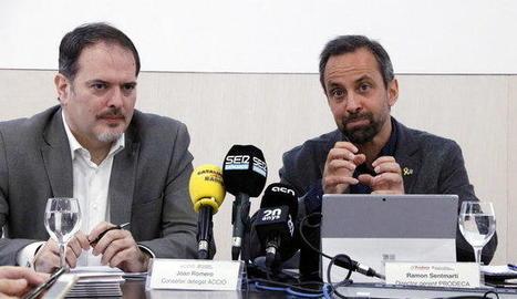 Joan Romero i Ramon Sentmartí, a la presentació de l'informe econòmic
