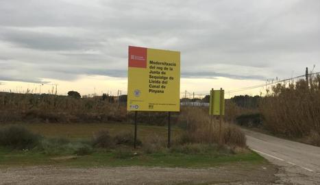 El cartell anunciador de les obres de modernització de l'Horta.