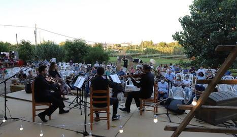Concert d'un quartet de corda, ahir a la primera cita del cicle 'Agrocultural' de l'Horta de Lleida a la Granja Pifarré, a la Caparrella.