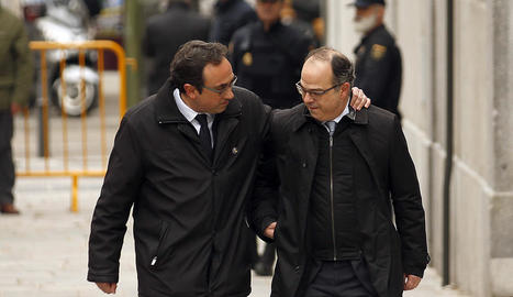 Imatge d'arxiu de Josep Rull i Jordi Turull a l'arribar al Tribunal Suprem durant el judici del procés.