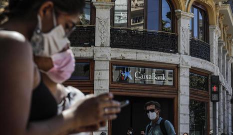 La nova CaixaBank serà el primer banc a Espanya.