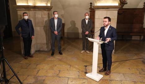 Farré, Talarn, Pueyo i Aragonès, ahir atenent els mitjans a l'ajuntament de Lleida.