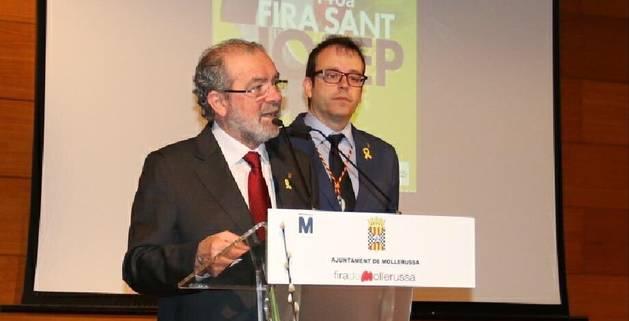 El president de la Diputació, Joan Reñé, i l'alcalde de Mollerussa, Marc Solsona, durant l'acte inaugural de la Fira de Sant Josep.