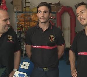 Els bombers sevillans Manuel Blanco, Julio Latorre i Quique Rodríguez.