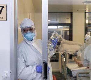 Diverses infermeres de la unitat de cures intensives (UCI) atenen un pacient infectat amb Covid-19